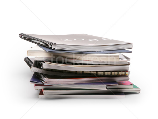 Stock photo: art stack of brochures on a white background