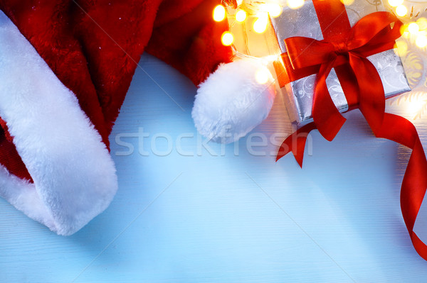 art Christmas  festive background with  gift box and hat of Sant Stock photo © Konstanttin
