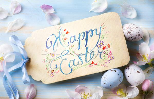 Joyeuses pâques fleurs du printemps œufs de Pâques printemps fond table Photo stock © Konstanttin