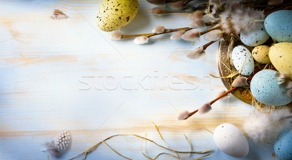 Easter background with Easter eggs and spring flowers. Top view  Stock photo © Konstanttin