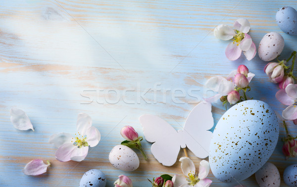 Easter background with Easter eggs and spring flowers. Top view  Сток-фото © Konstanttin