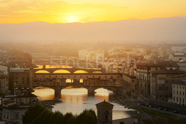 Evening over the Florence. Arno river and famous Ponte Vecchio e Stock photo © Konstanttin