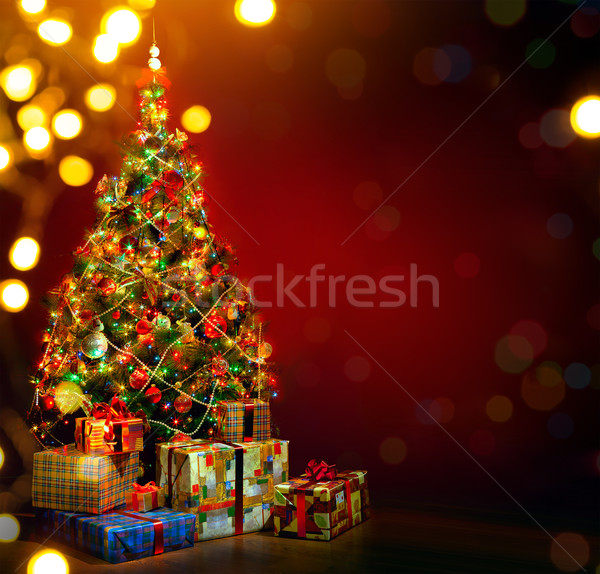 Art Christmas tree and holiday gift on red background Stock photo © Konstanttin