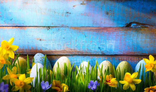 art Easter Background with easter eggs and spring flowers on gre Stock photo © Konstanttin