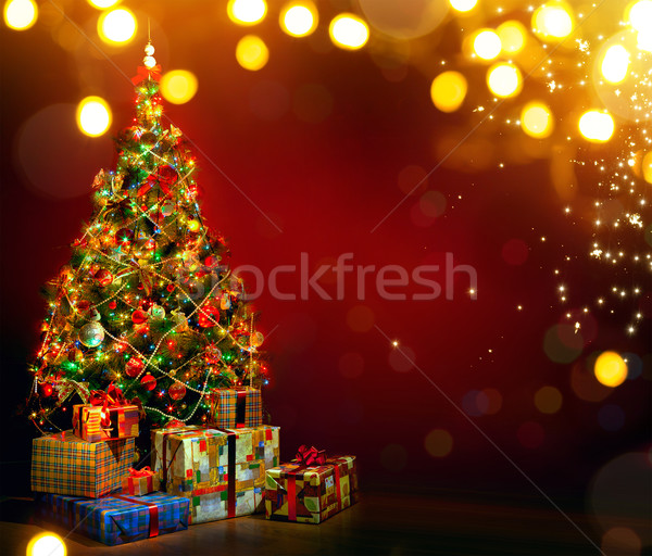 Beautiful decorated Christmas tree with present boxes and magic  Stock photo © Konstanttin