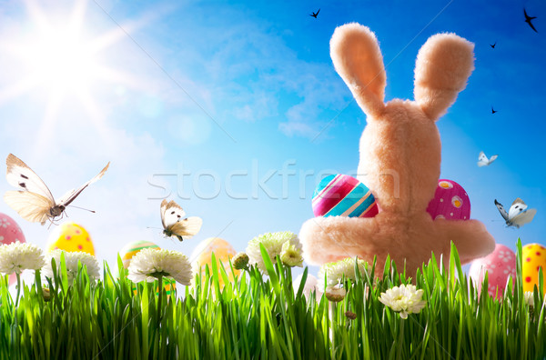 Stock photo: art  Easter teddy bunny and Easter eggs on green grass