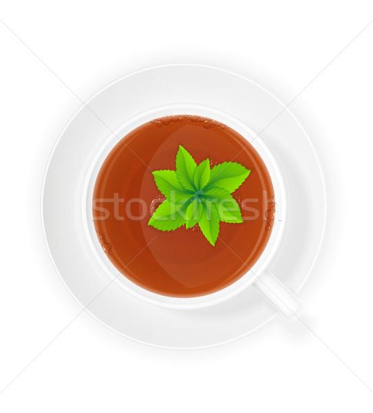 Porselein beker thee mint geïsoleerd witte Stockfoto © konturvid