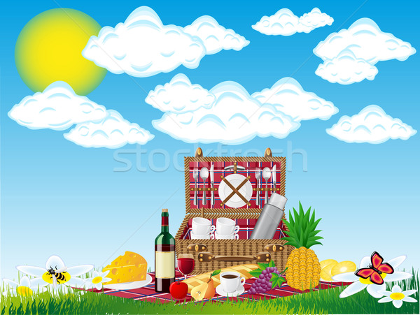 basket for a picnic with tableware and foods on nature Stock photo © konturvid
