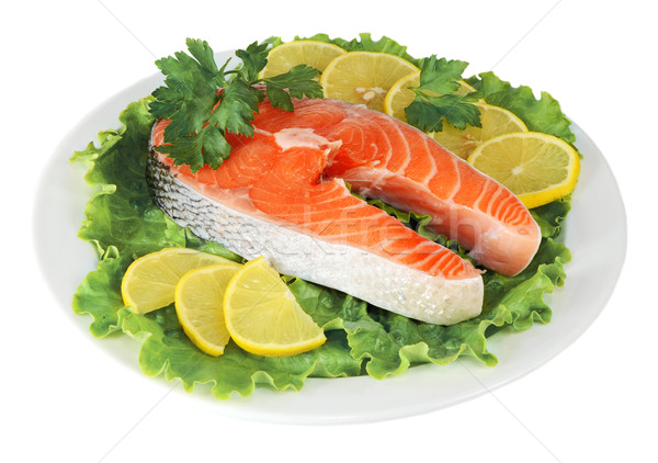 steaks of red fish with a lemon and parsley in dish Stock photo © konturvid