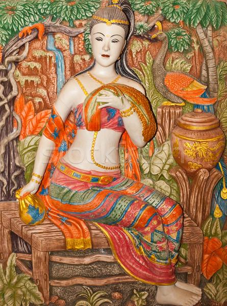 Low-relief image of beautiful woman  Stock photo © koratmember