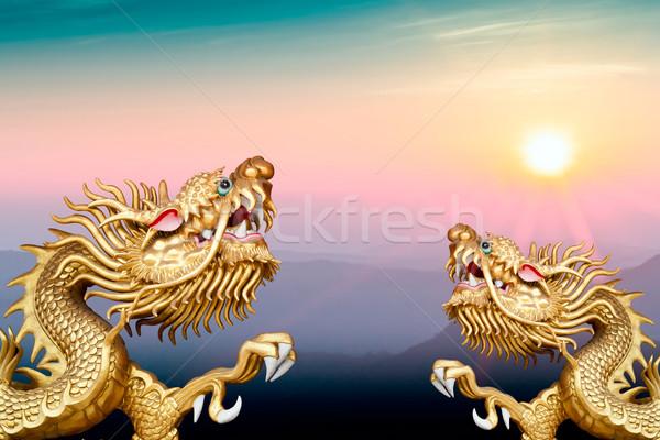 twin golden dragon on morning sunrise Stock photo © koratmember