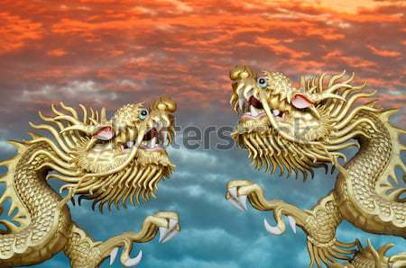 Stock photo: Duo Golden Chinese Dragon with global