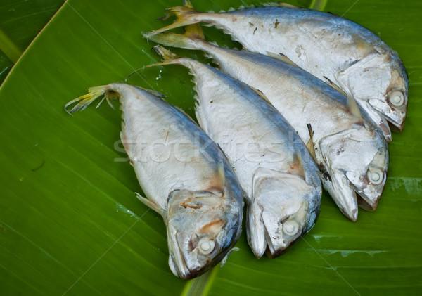 Négy főtt makréla hal zöld banán Stock fotó © koratmember