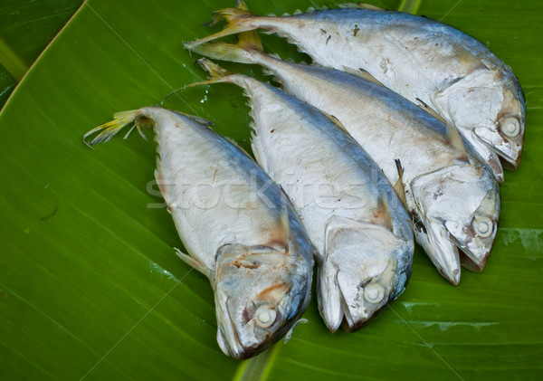 four boiled mackerel fish on green banana leaf Stock photo © koratmember