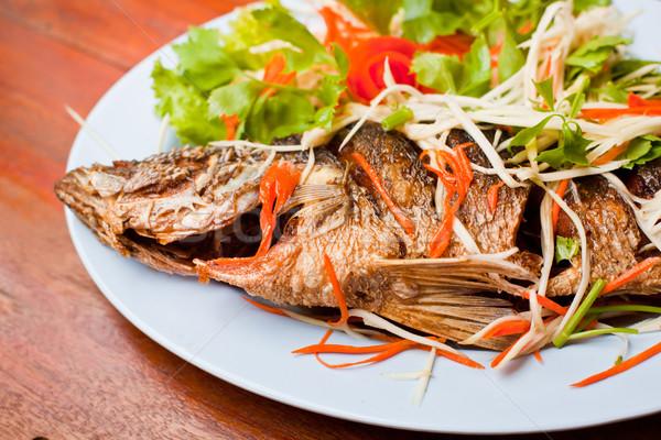 fried snapper fish Stock photo © koratmember