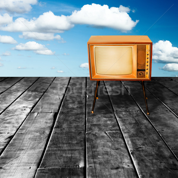 Old Vintage TV on  Perspective Old Wood Texture in Front of Blue Stock photo © koratmember