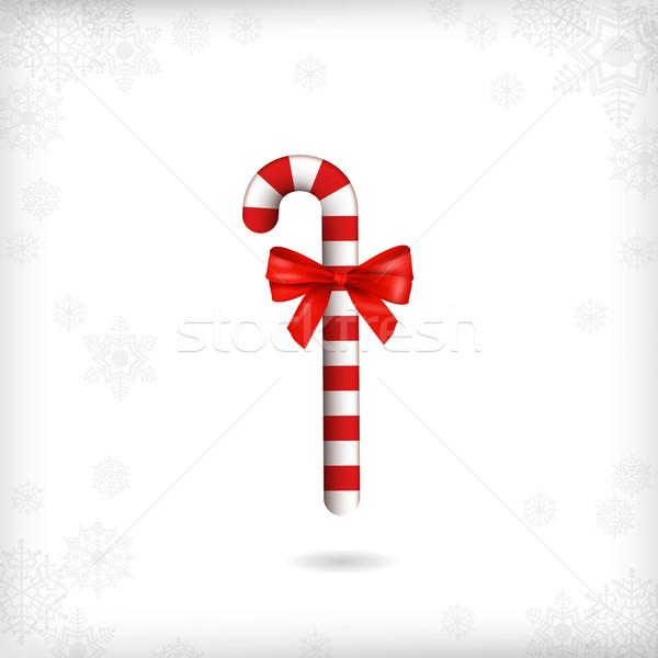 Noël bonbons canne rouge arc bâton Photo stock © kostins