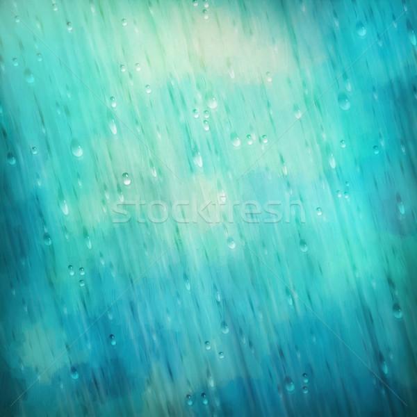 Colorido azul lluvia agua gotas borroso Foto stock © kostins