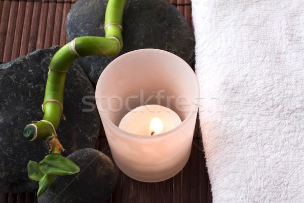Candela pietre asciugamano bianco bambù ramo Foto d'archivio © Koufax73
