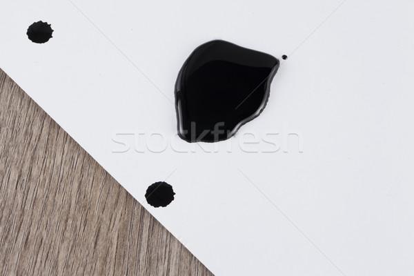 Negro mancha tinta blanco papel hoja Foto stock © Koufax73