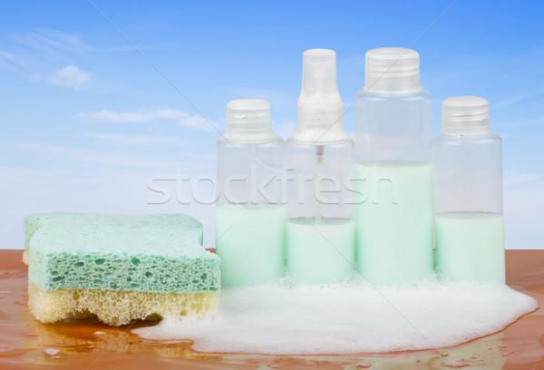 Savon quatre bouteilles bulles de savon éponge eau Photo stock © Koufax73