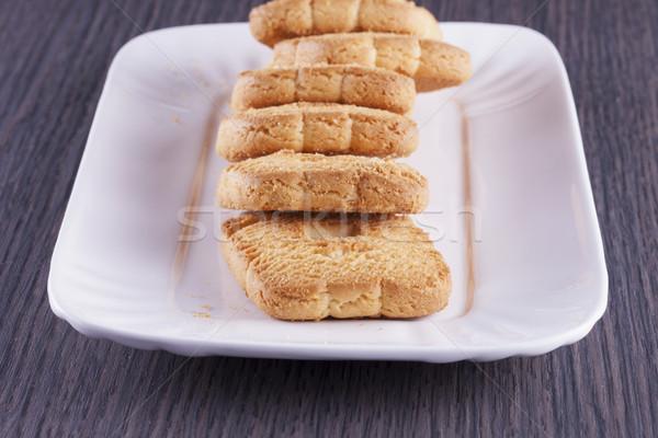 Kekszek fehér tányér csetepaté vízszintes kép Stock fotó © Koufax73