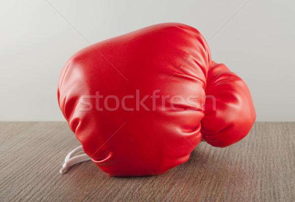 боксерская перчатка красный деревянный стол стены спорт технологий Сток-фото © Koufax73