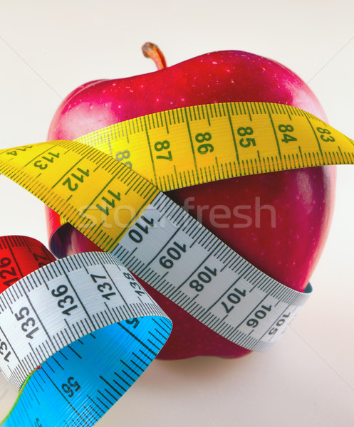 Apple and centimeter Stock photo © Koufax73