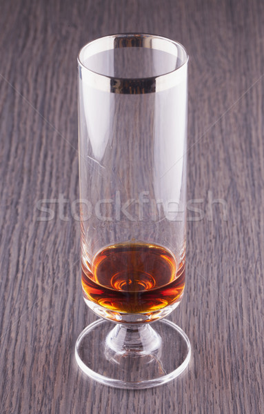 Szeszes ital üveg fa asztal bár koktél sötét Stock fotó © Koufax73