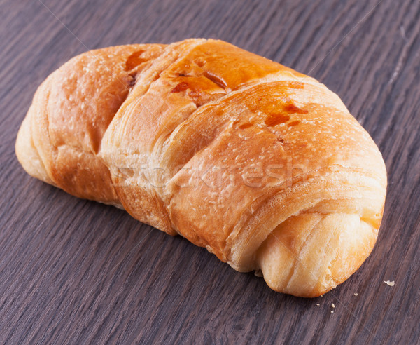 Croissant escuro mesa de madeira horizontal imagem madeira Foto stock © Koufax73