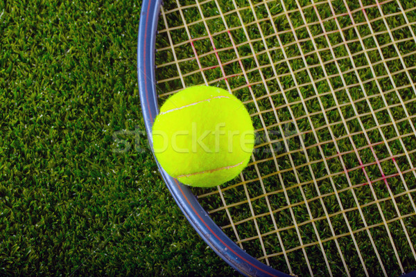 Tennis ball and racket over grass Stock photo © Koufax73