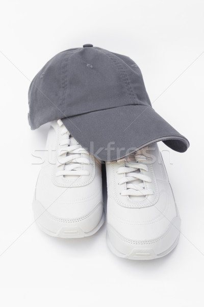 Running shoes and baseball cap Stock photo © kravcs