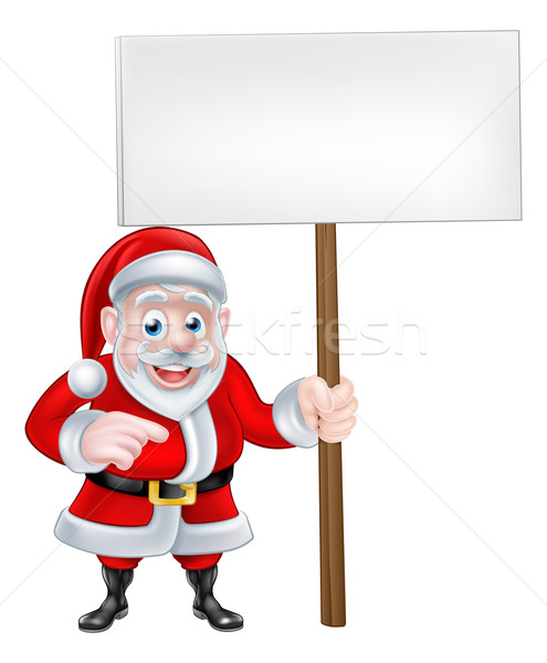 Santa Holding a Sign and Pointing Stock photo © Krisdog