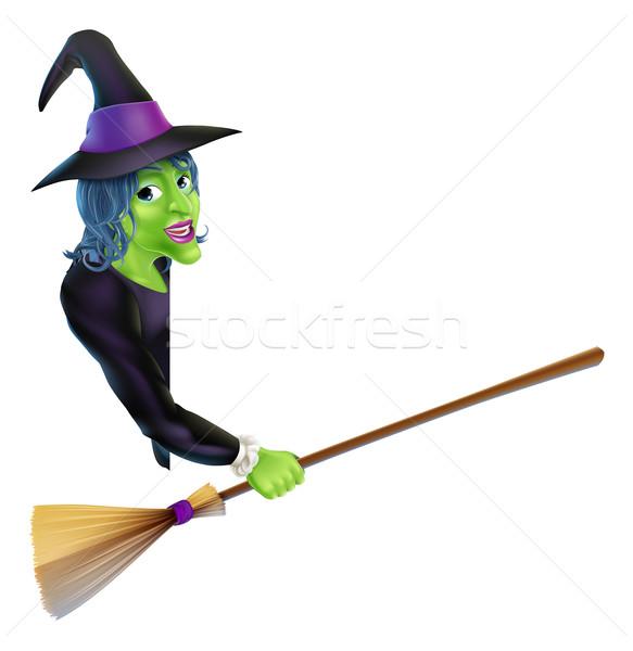Halloween Witch Pointing with Broom Stock photo © Krisdog