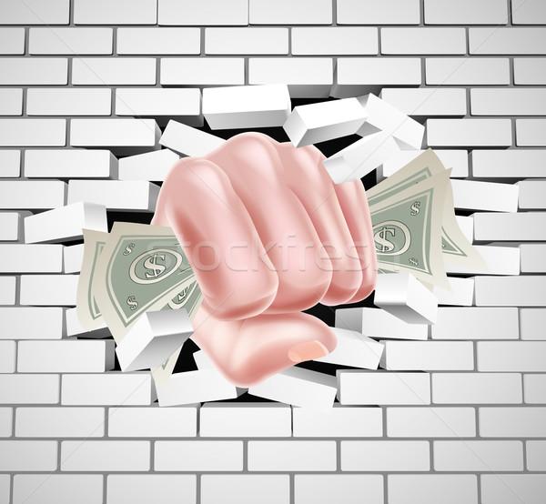 Money Fist Punching Through White Brick Wall Stock photo © Krisdog