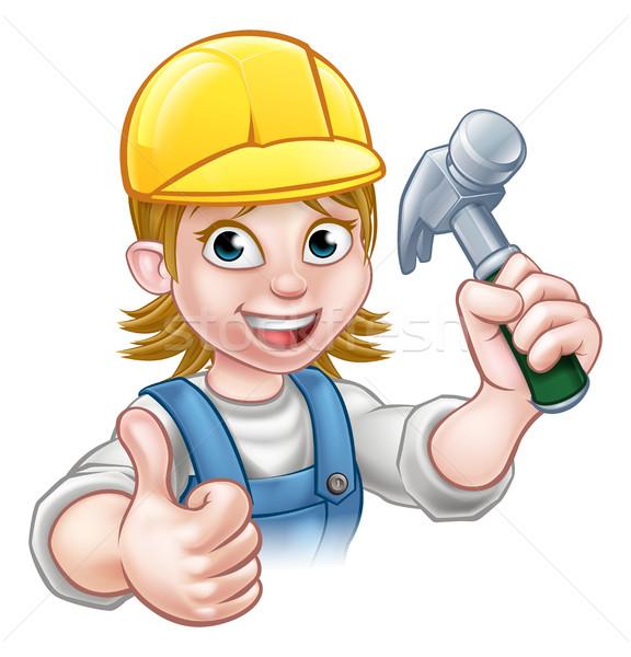 Woman Carpenter Holding Hammer Stock photo © Krisdog