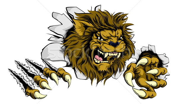 Lion ripping through background Stock photo © Krisdog