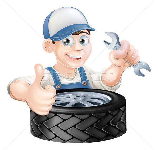 Auto mechanic giving thumbs up Stock photo © Krisdog