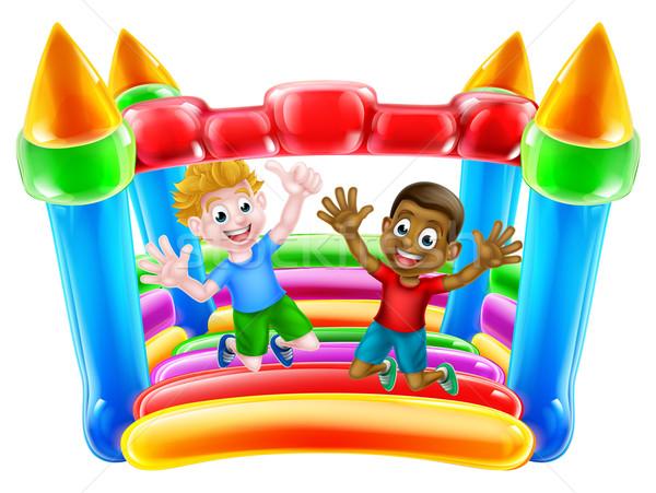 Kids Jumping on Bouncy Castle Stock photo © Krisdog