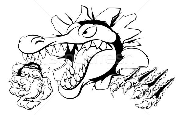 Alligator or crocodile smashing through wall Stock photo © Krisdog