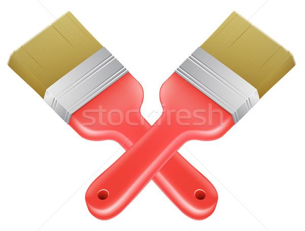 Paintbrushes crossed tools icon Stock photo © Krisdog