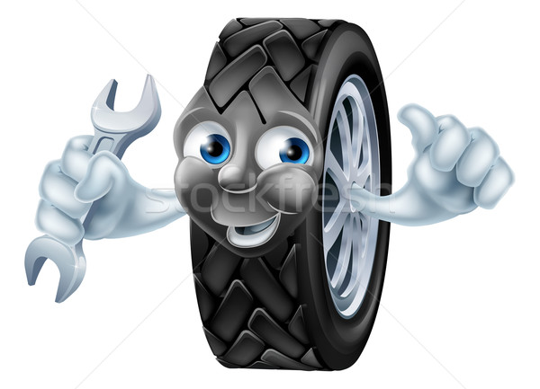Tyre mascot character with spanner Stock photo © Krisdog