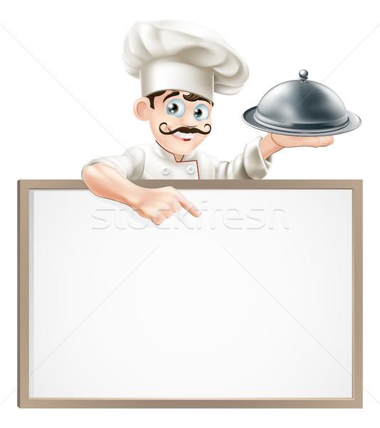 Chef pointing at sign Stock photo © Krisdog