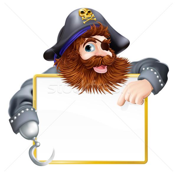 Happy pirate pointing at sign Stock photo © Krisdog