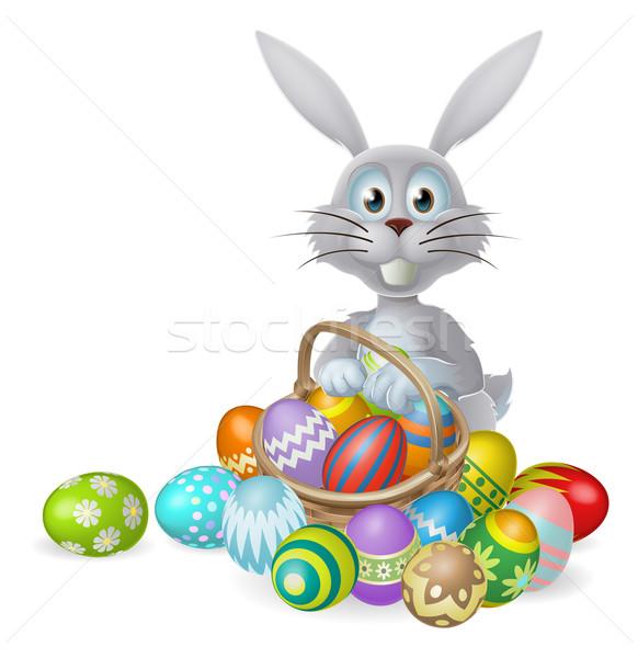 Húsvéti nyuszi csokoládé kosárnyi tojás fehér nyúl kosár Stock fotó © Krisdog