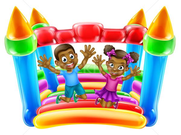 Children Jumping on Bouncy Castle Stock photo © Krisdog