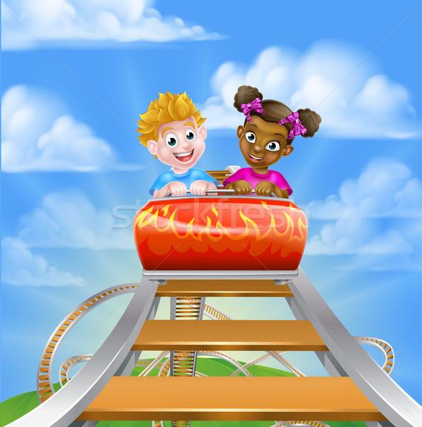 Montanha-russa feira parque desenho animado menino menina Foto stock © Krisdog