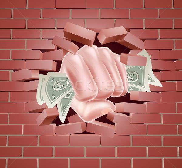 Money Fist Punching Through Wall Stock photo © Krisdog
