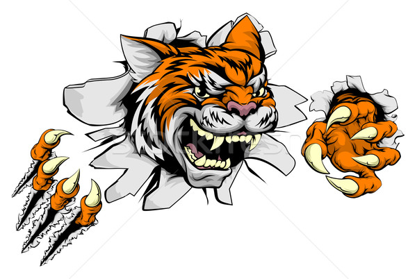 Tiger sports mascot ripping through wall Stock photo © Krisdog