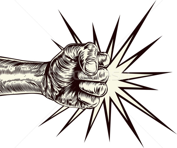 Stock photo: Fist punching wood cut